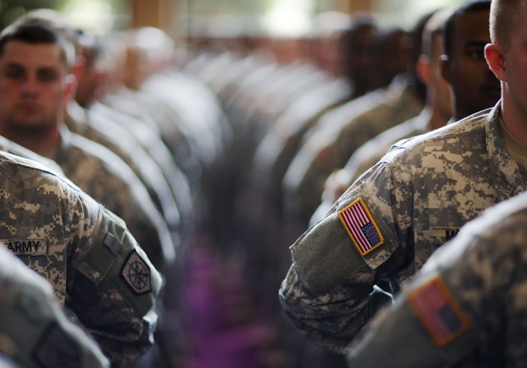 Image: Soldiers with the Georgia National Guard 876th Vertical EN Company file into a departure ceremony before the unit deploys to Afghanistan on May 29 in Toccoa, Ga.