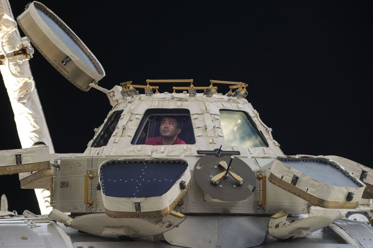 Image: Expedition 39 Commander Koichi Wakata of Japan peers out of one of the windows of the Cupola on the Earth-orbiting International Space Station.