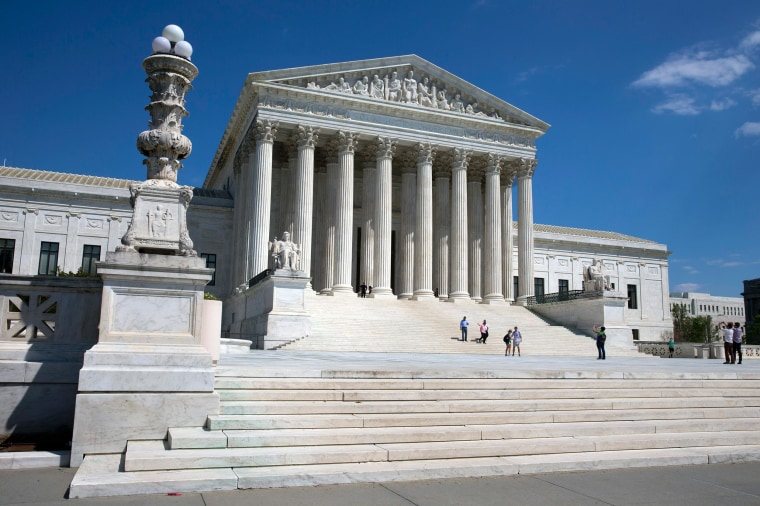 Image: People walk on the steps of the U.S. Supreme Court in Washington