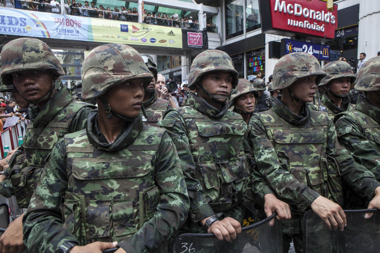 Image: Soldiers stand guard as anti-coup protesters rally in Bangkok, Thailand