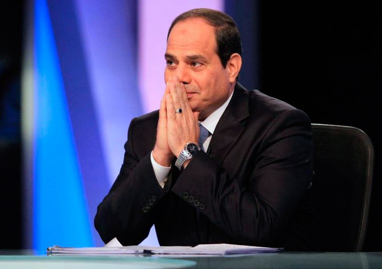 Image: Then-presidential candidate and former army chief Abdel Fattah el-Sissi talks during a television interview broadcast on CBC and ONTV, in Cairo