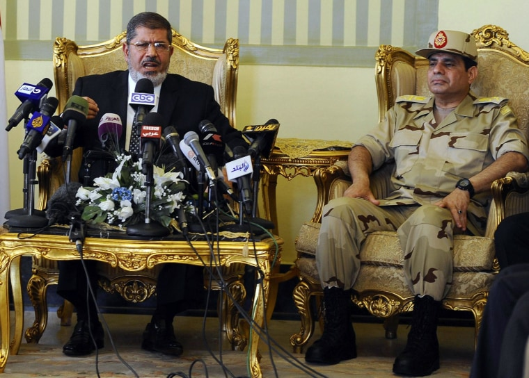 Image: Egypt's former President Morsi and then-Defense Minister el-Sissi attending a news conference in Cairo