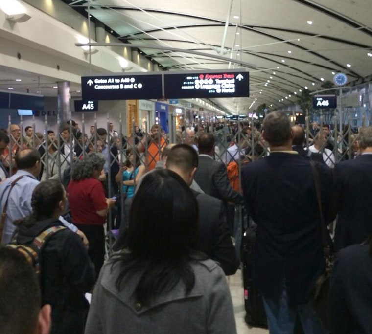 Passengers at Detroit airport faced delays after a passenger entered a secure zone without submitting to a security check.