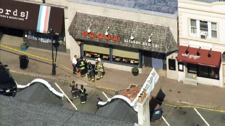 One person died and another was seriously injured after the floor of a popular New Jersey restaurant partially collapsed as workers were installing a staircase on May 30, 2014.
