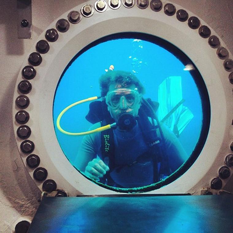 Image: Fabien Cousteau looks through the window of the Aquarius habitat in the Florida Keys National Marine Sanctuary, Florida