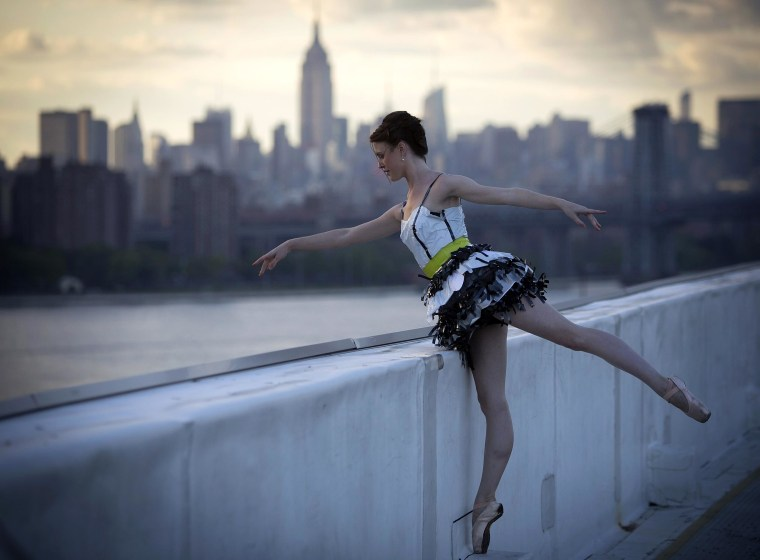 "Image: A model takes part in the ""Trashion\"" fashion show on the roof of a building in the Brooklyn Navy Yard"