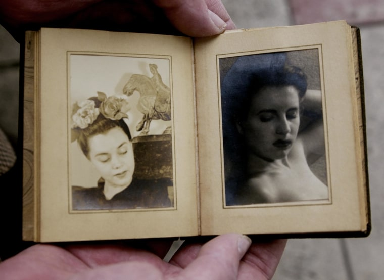 Image: Retired police homicide detective Steve Hodel displays two photographs of Elizabeth Short, known in 1947 as the Black Dahlia and the victim of a bizarre and brutal murder the same year