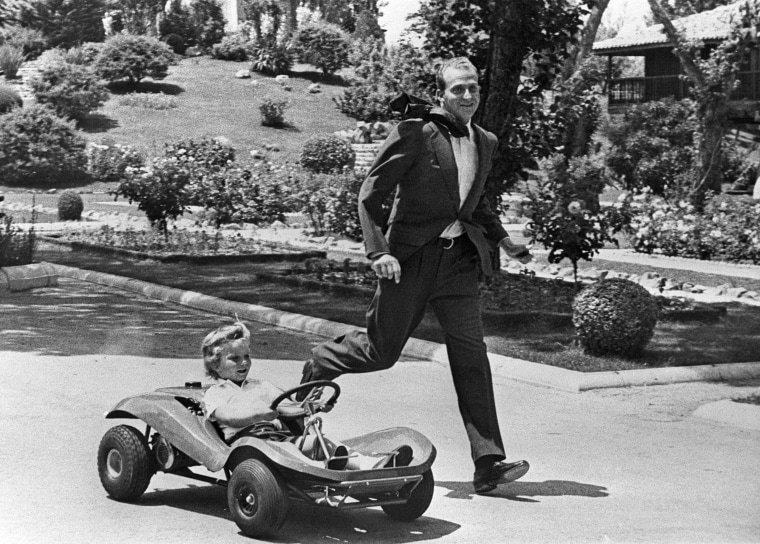 Image: Prince Juan Carlos of Spain playing with his son Don Felipe