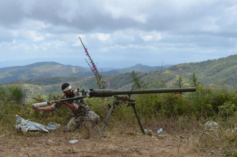 A rebel fighter loads an anti-tank cannon during fighting against pro-government forces on June 1, 2014 on the outskirts of Syria's Mediterranean port city of Latakia.