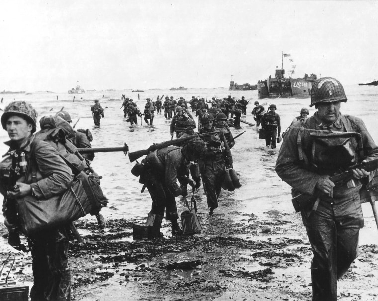 Image: Handout photo of U.S. reinforcements landing on Omaha beach during the Normandy D-Day landings near Vierville sur Mer