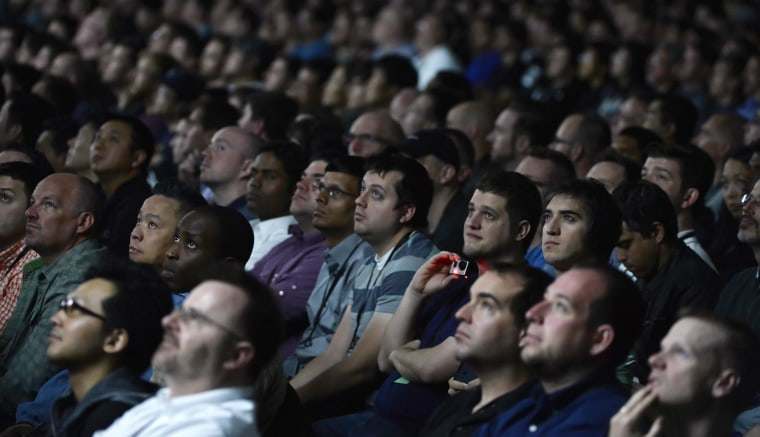 Image: Attendees listen to Apple CEO Tim Cook speaking during his keynote at the Apple Worldwide Developers Conference