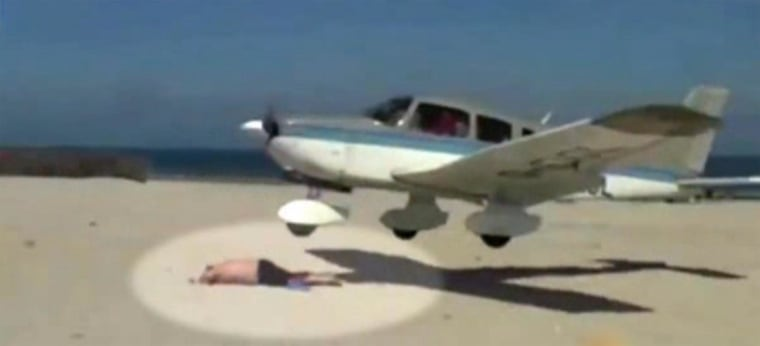 Plane nearly lands on sunbather