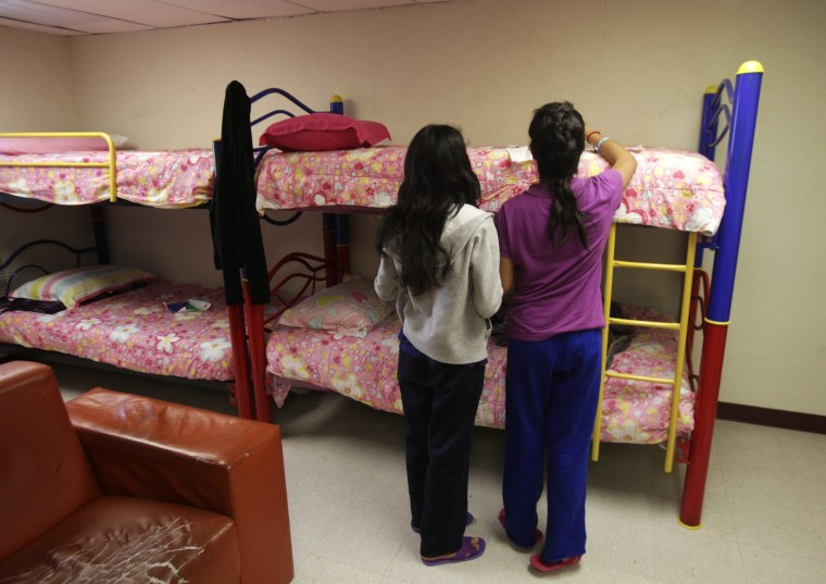 "Girls stand in a dorm at the shelter for underage immigrants and repatriated minors ""Mexico, my home"" in Ciudad Juarez May 27, 2014."