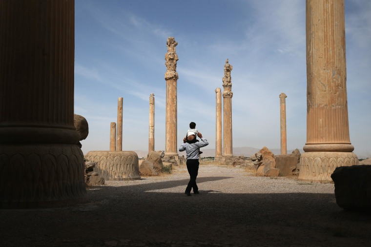 Image: Tourists walk through the ancient Persepolis archeological site on May 30 in Persepolis, Iran.