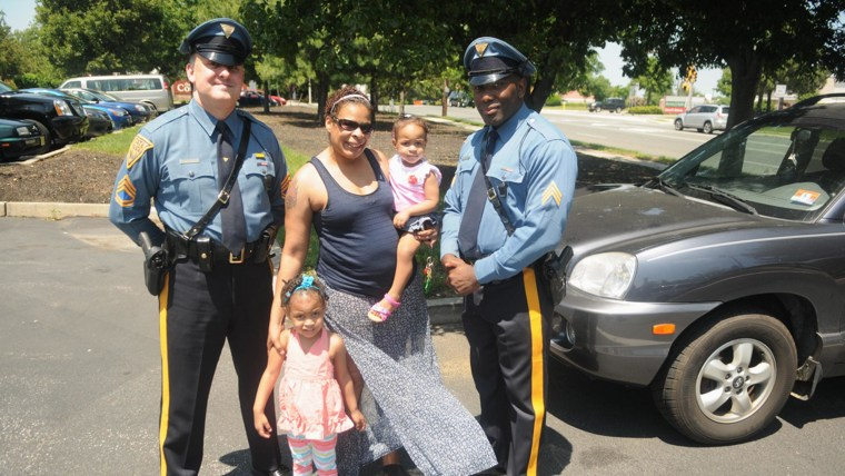 IMage: Shari Williams with Sgts. Flory (left) and Davis and her daughters Kristina, 3, and Diamon, 15-months.