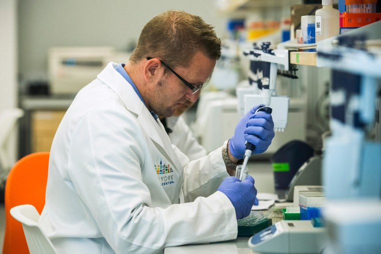 Research technicians prepare DNA samples to be sequenced in the production lab of the New York Genome Center on Sept. 19, 2013 in New York City. The Center, which is already operating with a staff of 51 people, aims to sequence and analyze DNA for academic and commercial purposes.
