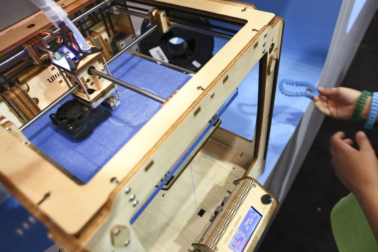 Image: An Ultimaker 3D printer prints a bracelet at the Ultimaker booth at the Maker Faire in San Mateo, Calif.