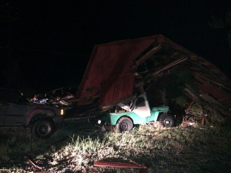 A barn collapsed on top of a vehicle after a storm passed through Hugo, Colorado.
