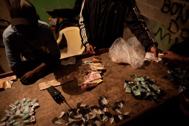 Image: Traffickers sell drugs in the Antares slum in Rio de Janeiro