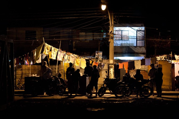 Image: Traffickers and users gather at a drug selling point in the Antares slum in Rio de Janeiro