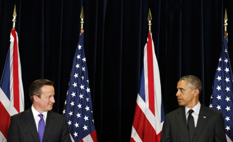 Image: U.S. President Obama and British PM Cameron look at each other as they speak at a joint news conference after their meeting at the G7 summit in Brussels