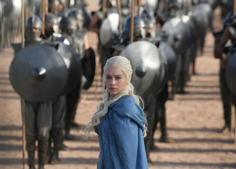 """This publicity image released by HBO shows Emilia Clarke in a scene from """"Game of Thrones."""" The program was nominated for an Emmy Award for outstanding drama series on, Thursday July 18, 2013. Clarke was also nominated for best supporting actress. The Academy of Television Arts & Sciences' Emmy ceremony will be hosted by Neil Patrick Harris. It will air Sept. 22 on CBS.. (AP Photo/HBO, Keith Bernstein)"""