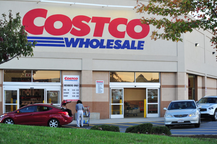 Image: A shopper loads items into her car after shopping at Costco Wholesale Club in Manassas, Virginia