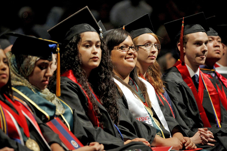 Maria Ortega, at center in glasses (4th from left), attending the Fresno State University Latino Commencement on May 17 in Fresno, Calif.