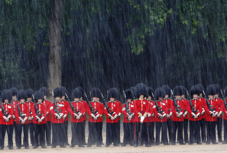 Scots Guards parade in the rain during the Colonel's Review ceremony in London on Saturday.The annual military parade and march-past by the British Army Household Division takes place a week before the Trooping of the Color which marks Queen Elizabeth's official birthday.