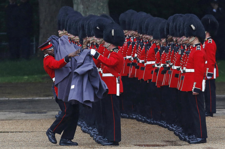Image: Guardsmen of the Grenadier Guards remove their capes during the Colonel's Review ceremony at Horse Guards Parade in London