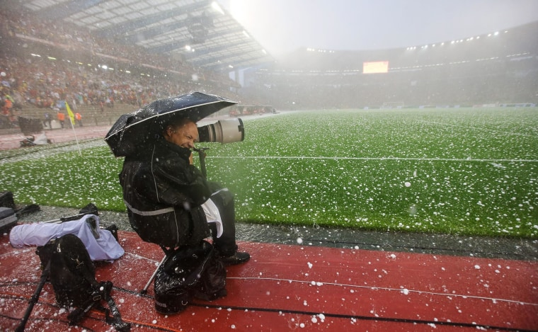 Image: A hailstorm interrupts an international friendly soccer match between Belgium and Tunisia at King Baudoin stadium in Brussels, Belgium