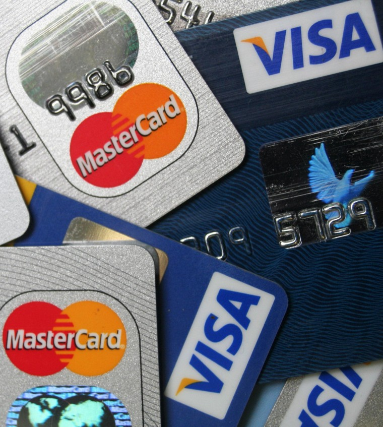 A pile of MasterCard and VISA credit cards.