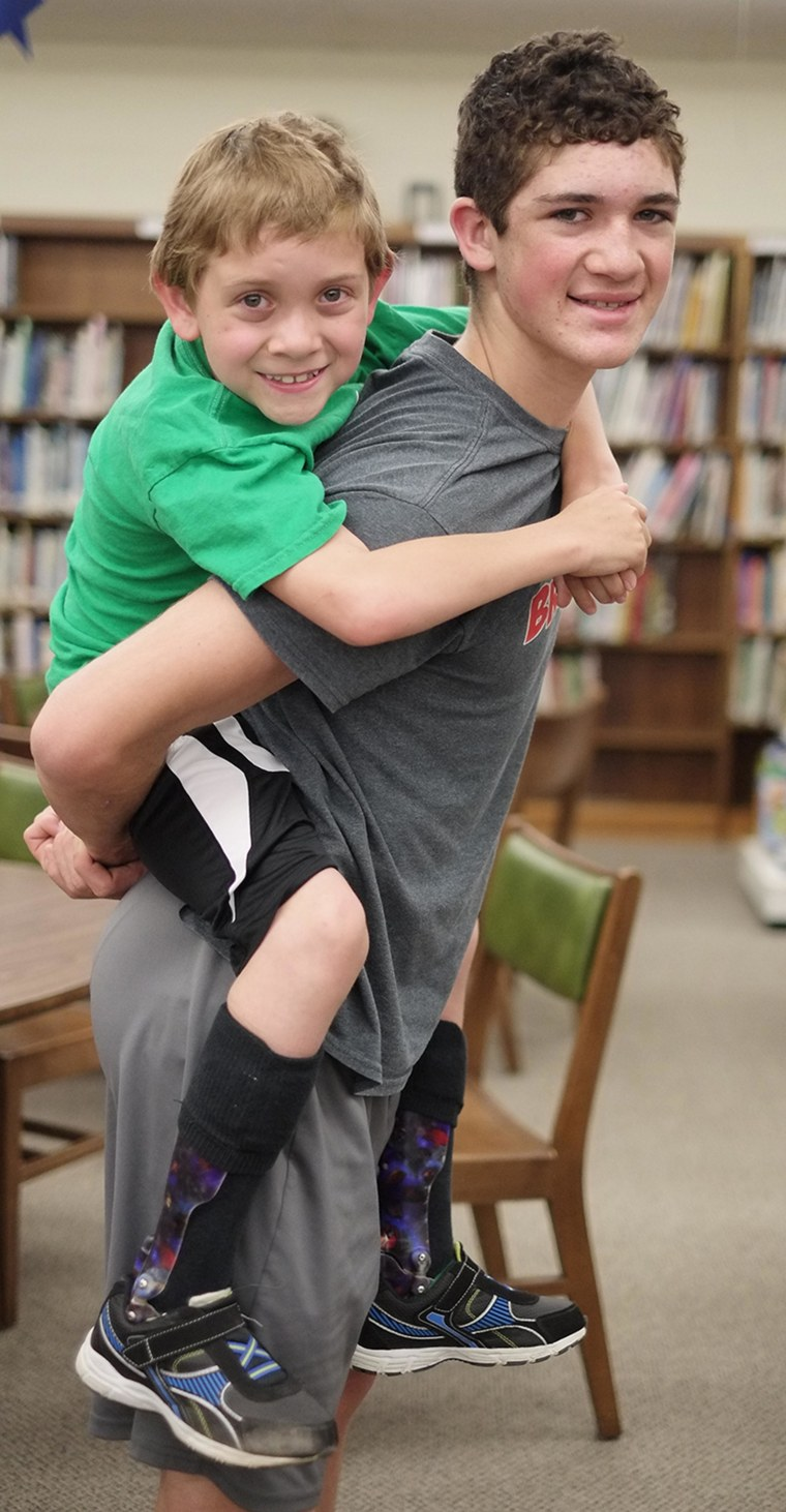 Image: Hunter Gandee, 14, and his brother Braden Gandee, 7, at Bedford Junior High School in Bedford, Mich.