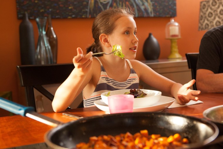 Isabelle Thomelin, 8, enjoys dinner at her home in Seattle. She was diagnosed as a toddler with a severe tree nut allergy and her parents, Toni and Philippe Thomelin, monitor her food carefully, especially after she suffered a life-threatening reaction to a mislabled snack food last summer. Undeclared allergens are a leading cause of food recalls in the United States, experts say.