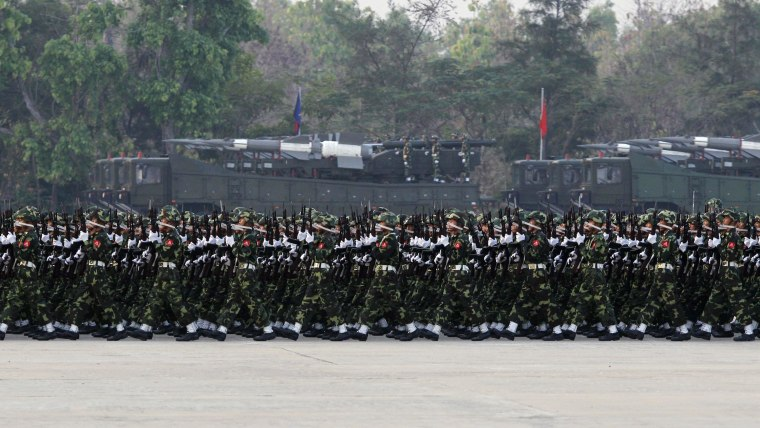 Image: Soldiers march during a parade to mark the 69th Armed Forces Day in Myanmar's capital Naypyitaw
