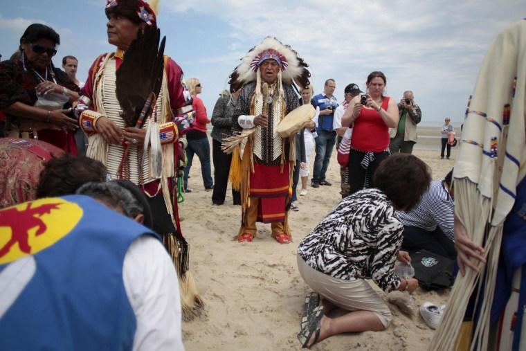 Image: Descendants of Comanche indian soldiers pray on Utah Beach