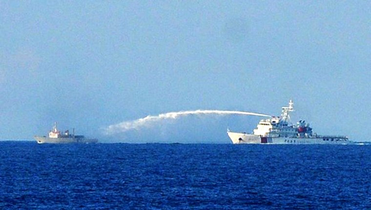 This picture taken on June 2, 2014 shows a Chinese Coast Guard ship (R) using a water cannon to attack a Vietnamese Fisheries Surveillance boat near to the site of the Chinese oil rig in disputed waters of the South China Sea off Vietnam's central coast. China fired water cannons at a Vietnamese vessel and damaged another of Hanoi's ships, Chinese state media said on June 3, in the latest confrontation over disputed waters in the South China Sea.