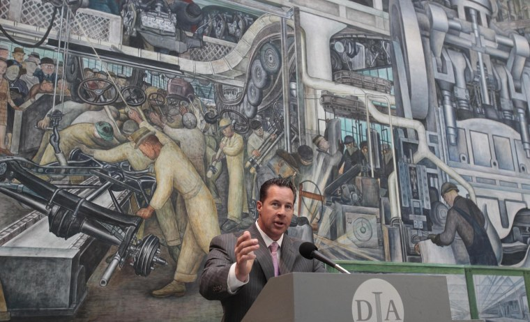 Chrysler Group U.S. Sales head Reid Bigland stands in front of The Detroit Industry fresco by Mexican muralist Diego Rivera during a news conference to announce foundation pledges to the Detroit Institute of Arts on June 9, 2014.
