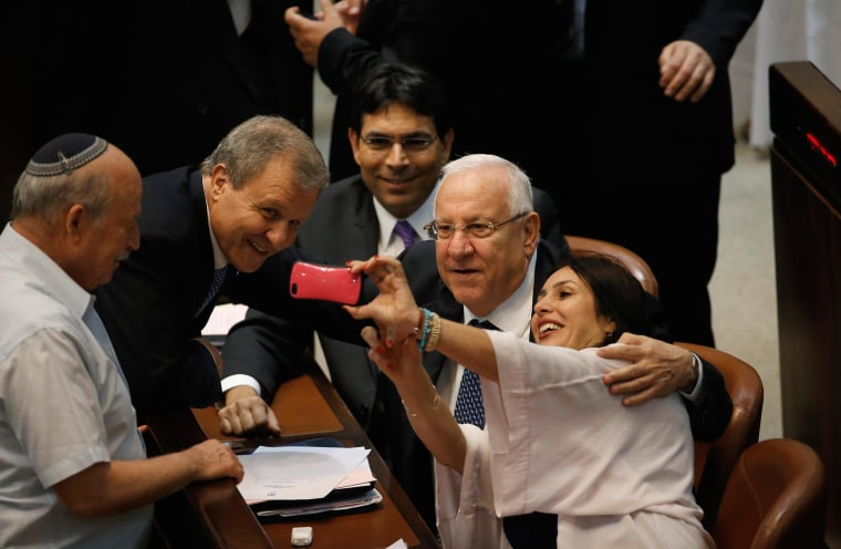 Image: Regev takes a selfie with Rivlin and Sheetrit at the Knesset, in Jerusalem