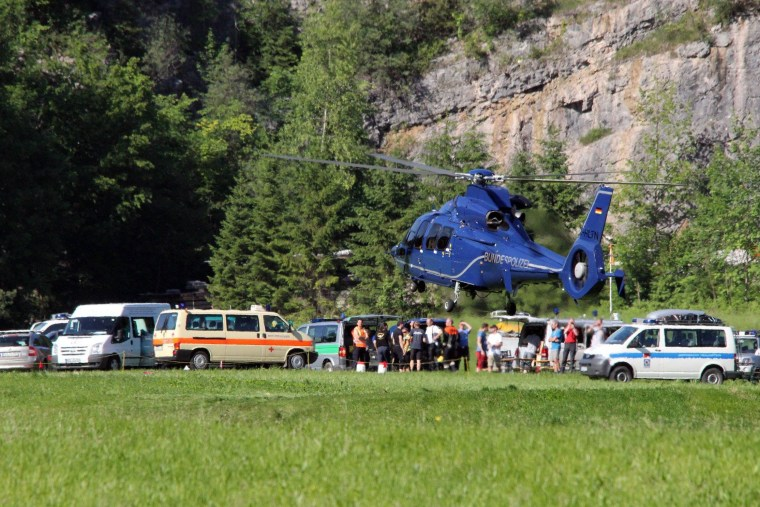 Image: Rescuers make contact as injured man in German cave awaits freedom
