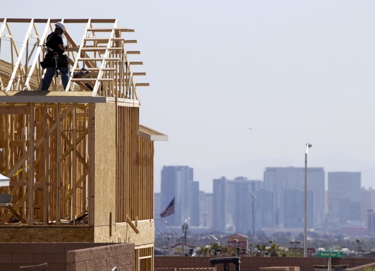 Image: Carpenters work on new homes at a residential construction site in the west side of the Las Vegas Valley in Las Vegas