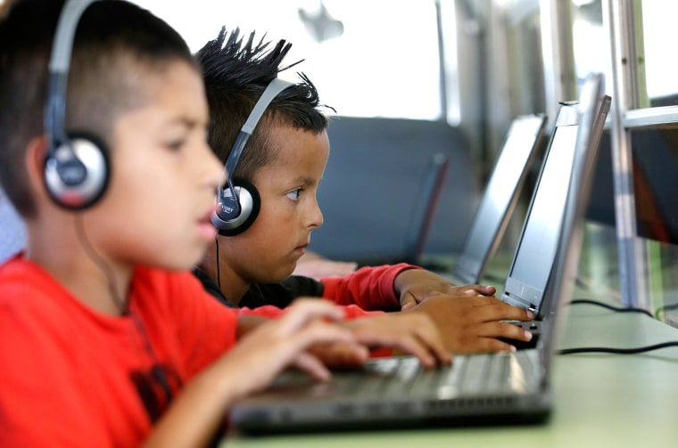 Children play on computers.