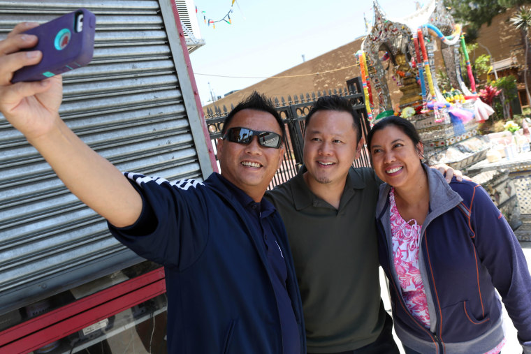 Chef Jet Tila photographed with two fans in the Thai Town area of Los Angeles, June 5, 2014.