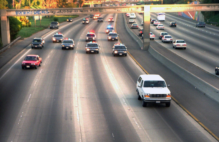 A white Ford Bronco, driven by Al Cowlings and carrying O.J. Simpson, is trailed by Los Angeles police cars as it travels on a Southern California freeway in Los Angeles, June 17, 1994.