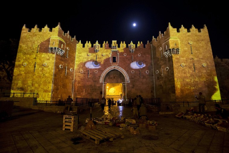 Image: A light projection show is seen on the Damascus Gate
