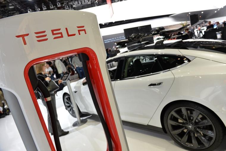 Image: Tesla car at charging station