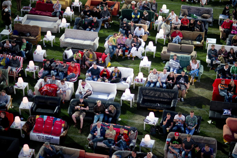 Image: German soccer fans watched the opening game of the World Cup on sofas in Berlin on Thursday.