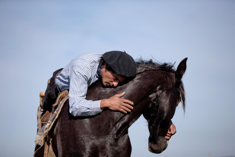 Image: Martin Tata embraces his horse Milonga