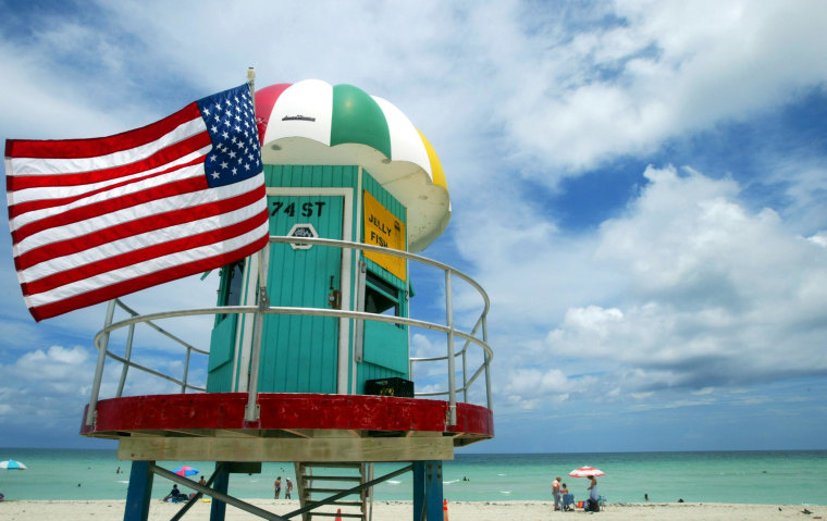 The average American plans to lay out about $1,900 for a family getaway this summer, a CNBC survey shows.
