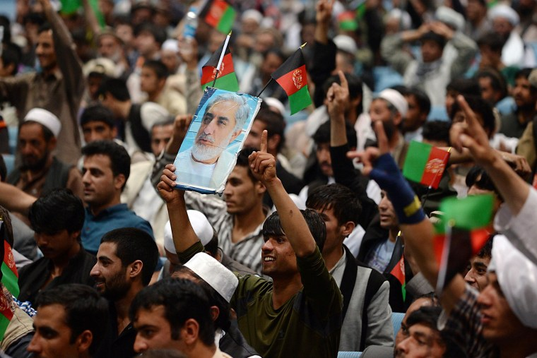 Image: A supporter of Afghan presidential candidate Abdullah Abdullah